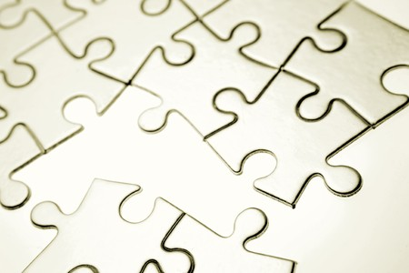 Jigsaw puzzle pieces on white Stock Photo - 7448851