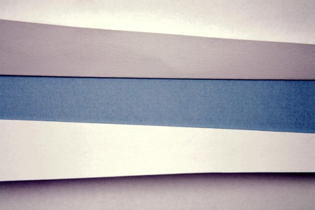 Ripped  paper on blue background  Stock Photo - 7448865