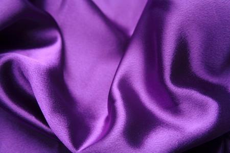 Close-up of purple shiny silk fabric photo