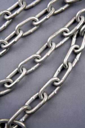 Steel chains on blue background  Stock Photo - 7471285
