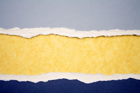 Ripped  paper on yellow background Stock Photo - 7471351