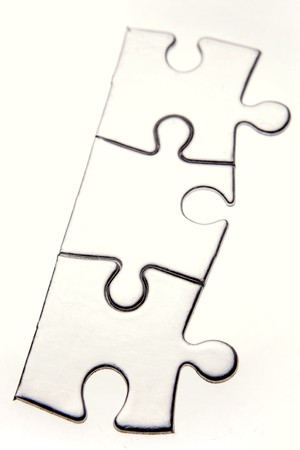 Three jigsaw puzzle pieces on white Stock Photo - 7471306