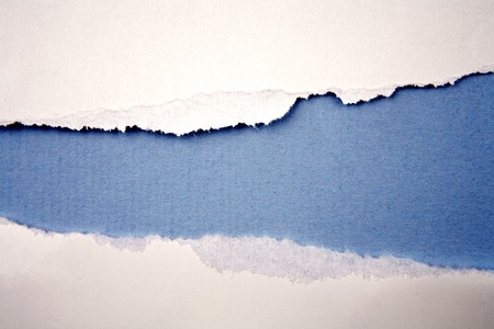 Ripped  paper on blue background  Stock Photo - 7489365