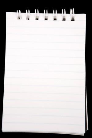 Open notebook on black background photo