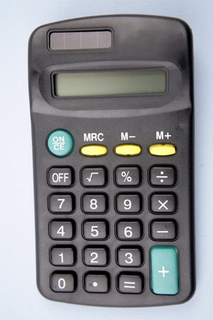 Close-up of calculator on blue background  photo