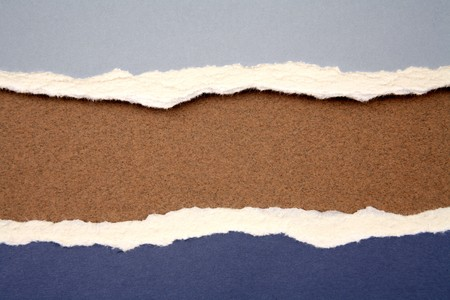 ripped paper background: Ripped  paper on brown background