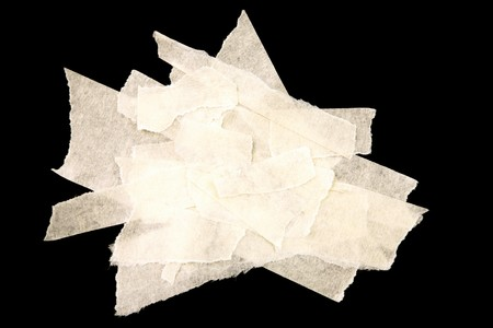 tear duct: Pieces of masking tape on black  Stock Photo