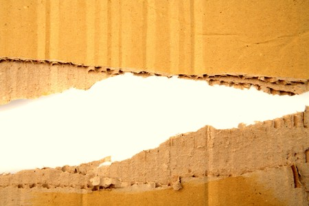 Hole ripped in corrugated cardboard Stock Photo - 7556995