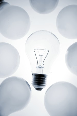 One clear light bulb in group photo