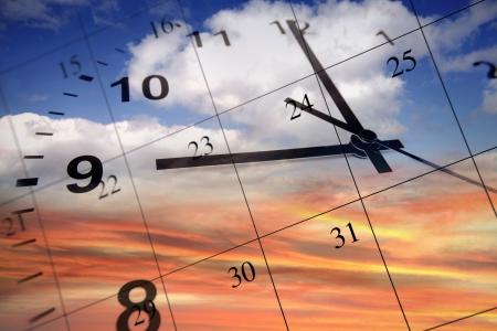 Clock face and calendar on sky photo