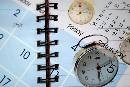 Clocks and calendar on diary  Stock Photo - 7617502