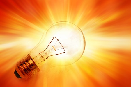 Light bulb on bright background photo
