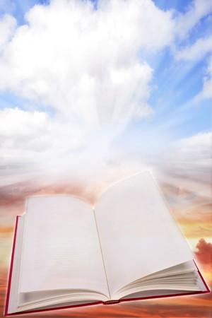 Open book on a heavenly scene photo