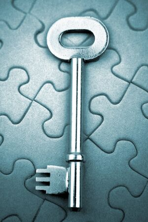 Single key resting on jigsaw puzzle Stock Photo - 7658010