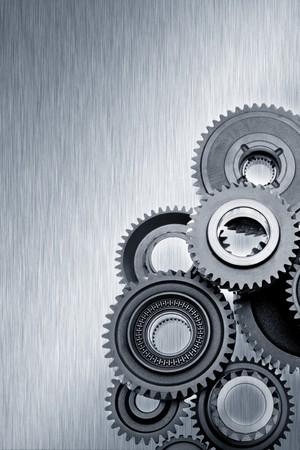 aluminum wheels: Metal gears on shiny steel Stock Photo
