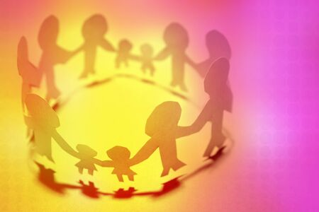 hands joined: Paper doll families holding hands  Stock Photo