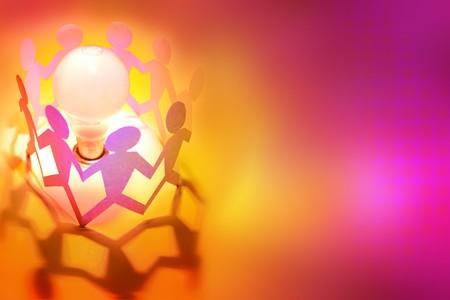 intelligent partnership: Paper doll people holding hands around light bulb  Stock Photo