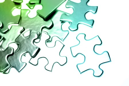 Jigsaw puzzle pieces scattered on color background  Stock Photo - 7733409