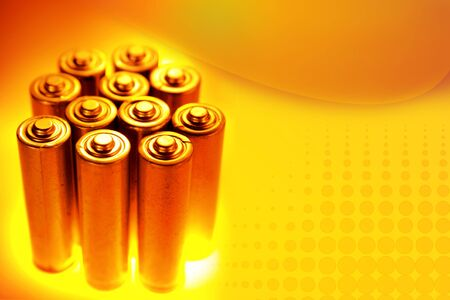 energize: Group of batteries on yellow background. Copy space Stock Photo