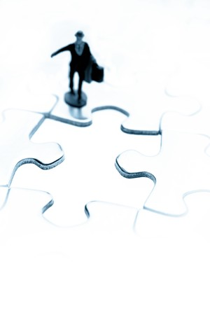 Figure looking at gap in jigsaw puzzle  Stock Photo - 7733398