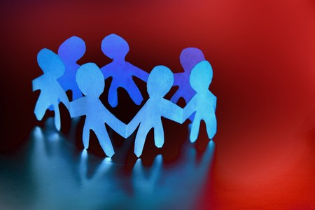 Group of paper doll people holding hands Stock Photo - 7733412