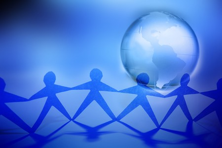 Team united together holding hands. Americas on globe Stock Photo - 7733404