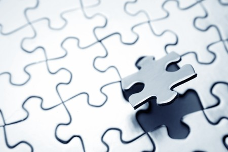 final piece of the puzzle: Final piece of jigsaw puzzle Stock Photo