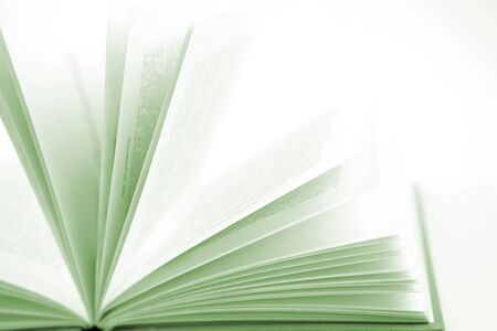 Open book on plain background photo