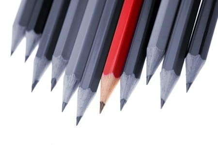 standing out from the crowd: One red pencil standing out from dull pencils Stock Photo