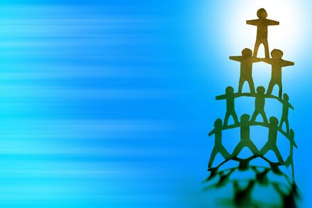 Human team pyramid on blue color background photo