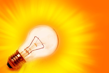 Light bulb on bright background