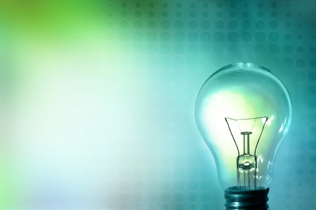idea lamp: Light bulb glowing on color background