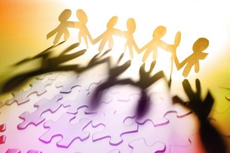 entreprise puzzle: Groupe de personnes et de pi�ces de casse-t�te Banque d'images