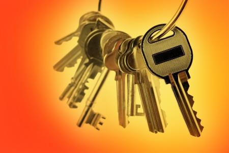 Bunch of keys on orange tone background photo