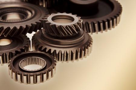 Metal gears on plain background Stock Photo - 7893099