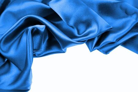 Closeup of crumpled blue silk fabric over white Stock Photo - 7893105
