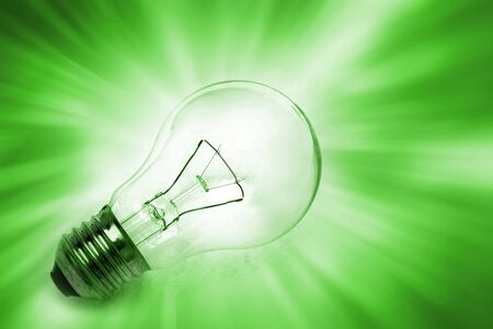 Light bulb on bright background photo