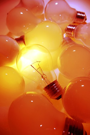 One bright bulb in crowd Stock Photo - 7893103