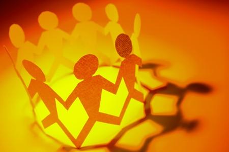 Grupo de personas celebrando las manos en un círculo  Foto de archivo
