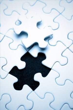 Last piece of jigsaw puzzle  photo