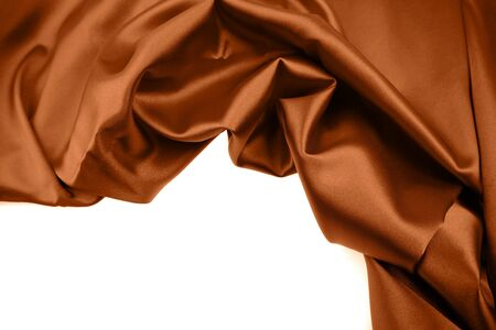 Closeup of crumpled brown silk fabric over white  Stock Photo - 7893164