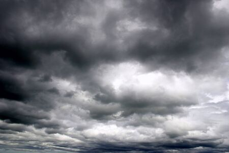 ominous: Dark ominous clouds. Dramatic sky. Stock Photo