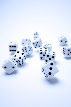 luckiness: Group of dice falling. Blue tone. Vertical