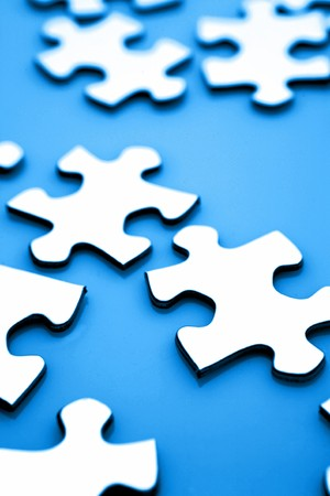 Jigsaw puzzle pieces on blue Stock Photo - 8077388