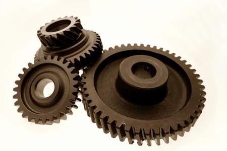 Metal gears on plain background Stock Photo - 8077371