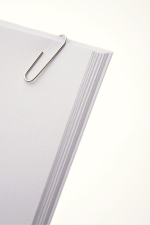 Paper clip holding papers together   photo