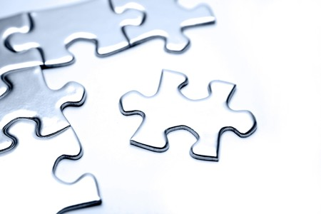 Jigsaw puzzle pieces on white  Stock Photo - 8089661