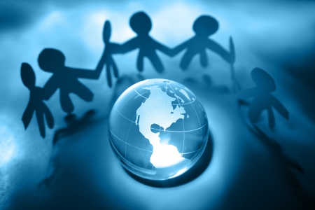 bonding: Team united together holding hands. Americas on globe   Stock Photo