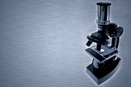 Microscope on grey background. Copy space    photo