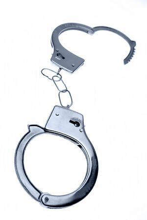 Handcuffs isolated on plain background Stock Photo - 8262064